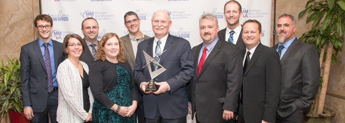 2017 John G. Thodis Michigan Manufacturer of the Year Award winner Phil Sponsler (center) and the team from Orbitform
